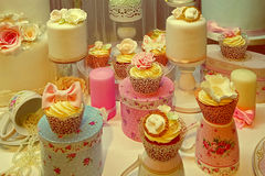Vintage look with cakes prepared for an festive event Royalty Free Stock Photography