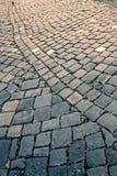 Vintage look at cobblestone sidewalk royalty free stock image