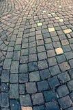Vintage look at cobblestone sidewalk royalty free stock photos