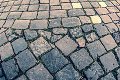 Vintage look at cobblestone sidewalk Royalty Free Stock Images