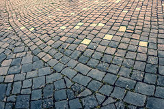 Vintage look at cobblestone sidewalk stock photo