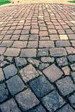 Vintage look at cobblestone sidewalk royalty free stock photo