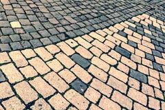 Vintage look at cobblestone sidewalk royalty free stock images