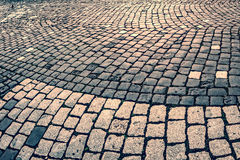 Vintage look at cobblestone sidewalk Royalty Free Stock Image