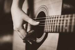 Female hand playing on guitar royalty free stock photos