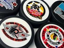 Vintage NHL All-Star Pucks. Vintage look at five NHL hockey pucks with All-Star logos Stock Photo