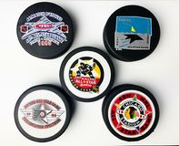 Vintage NHL All-Star Pucks. Vintage look at five NHL hockey pucks with All-Star logos Stock Photos