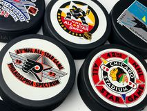 Vintage NHL All-Star Pucks. Vintage look at five NHL hockey pucks with All-Star logos Royalty Free Stock Images