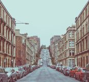Vintage look Glasgow hill. Vintage looking Gardner Street, the steepest road on Glasgow hills Stock Photography