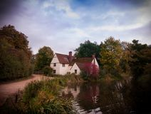 Vintage Look Stunning Autumn English Country Mill Cottage House. Willy`s lott`s famous old white cottage house in flatford suffolk Royalty Free Stock Photos