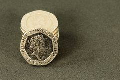 Vintage looking British Pound coins; currency of the UK royalty free stock image