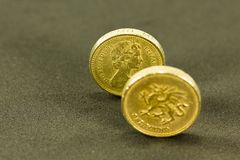 Vintage looking British Pound coins; currency of the UK stock photo