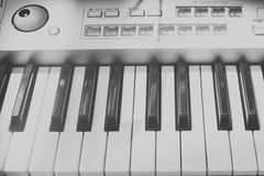 Vintage looking Detail of black and white keys on music keyboard Royalty Free Stock Image