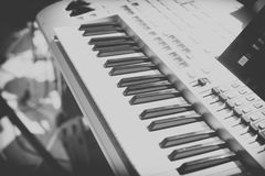 Vintage looking Detail of black and white keys on music keyboard Stock Image