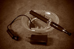 Vintage Looking Electronic Cigarette with Charger Royalty Free Stock Image