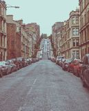 Vintage look Glasgow hill. Vintage looking Gardner Street, the steepest road on Glasgow hills Royalty Free Stock Images