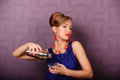 Vintage looking girl holding up shaker stock photos