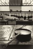 Antique XIX century old kitchen with tools, pans, pots and food ingredients. Vintage looking image of an antique XIX century old kitchen with tools, pans, pots stock photo