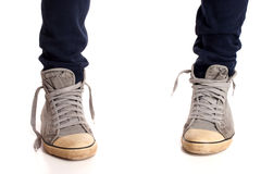 Vintage looking sneakers and ripped jeans Stock Image