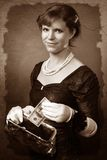 Vintage looking woman with dollar and purse Royalty Free Stock Photos