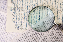Vintage Loupe and Letters Stock Photo