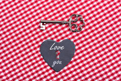 Vintage love hart key. Old key with heart on texture Royalty Free Stock Photo