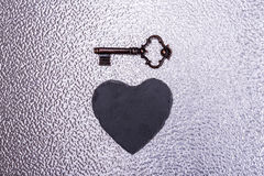 Vintage love hart key. Old key with heart on texture Royalty Free Stock Photos