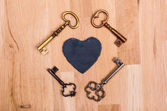 Vintage love hart keys. Old keys with heart on wood Royalty Free Stock Image
