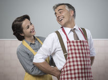 VIntage loving couple in the kitchen Stock Images