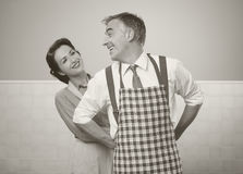 VIntage loving couple in the kitchen Stock Photography