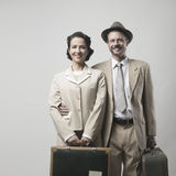 Vintage loving couple leaving for honeymoon Royalty Free Stock Images