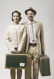 Vintage loving couple leaving for honeymoon Stock Images