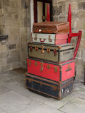 Vintage Luggage. Old suitcases stacked on a trolley royalty free stock photo