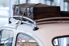 Vintage Luggage. On the roof of a car Royalty Free Stock Photography