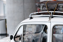 Vintage Luggage. On the roof of a car Stock Photography