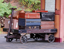 Vintage Luggage on a railway station platform. Traditional English Railway Station Platform with Vintage luggage on a trolley Royalty Free Stock Image