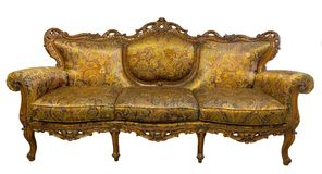 Vintage luxury Golden sofa Armchair isolated on white Stock Images