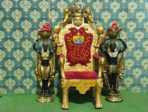 Vintage luxury throne chair with two egyptian stat stock photos