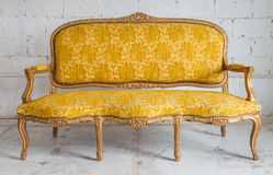 Vintage luxury yellow sofa Royalty Free Stock Images