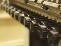 Vintage machine. Knob; machine; offset; plunger; potentiometer; press; print; vintage Stock Image