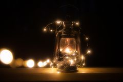Vintage magic lantern with lights at night royalty free stock images