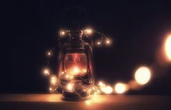 Vintage magic lantern with lights at night stock photography