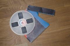 Vintage magnetic audio reel on the grunge wooden floor Stock Photo