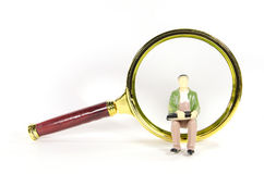 Vintage magnify glass with oldman toy model Stock Photo
