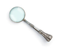 Vintage magnifying glass. Vintage decorative magnifying glass  on white background Stock Images