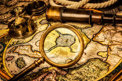 Vintage magnifying glass lies on the ancient map of the North Po Stock Images