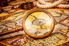 Vintage magnifying glass lies on the ancient map of the North Po Royalty Free Stock Photo