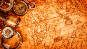Vintage magnifying glass lies on an ancient world map Stock Image