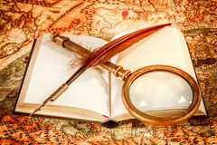 Vintage magnifying glass lies on an ancient world map Royalty Free Stock Images