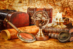 Vintage magnifying glass lies on an ancient world map Stock Images